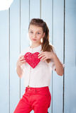 Girl holding red heart and looking at the camera Royalty Free Stock Image