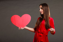 Girl holding red heart love sign Stock Image