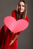Girl holding red heart love sign Royalty Free Stock Photography
