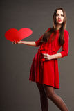 Girl holding red heart love sign Royalty Free Stock Images