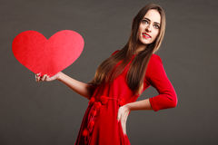 Girl holding red heart love sign Royalty Free Stock Photos