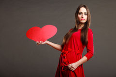 Girl holding red heart love sign Stock Images