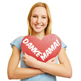 Girl holding red heart for mother's day Royalty Free Stock Images