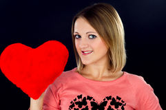 Girl holding a red heart Stock Photo