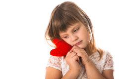 Girl holding a red knit heart,  Valentine's Day Royalty Free Stock Photos