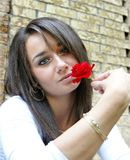 Girl holding a red rose Royalty Free Stock Photos