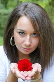 Girl holding a red rose Stock Photos