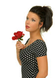 Girl holding a red rose. Picture of beautiful young woman holding a red rose on the white background Stock Image