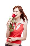 Girl holding red rose Stock Image