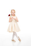 Girl holding red rose Royalty Free Stock Images