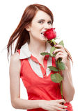 Girl holding red rose Royalty Free Stock Image