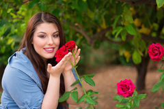 Girl holding red roses Stock Photo