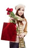 Girl holding red shopping bag Royalty Free Stock Photography