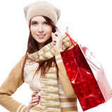 Girl holding red shopping bag Stock Photos