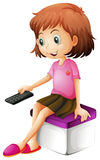 A girl holding a remote control Royalty Free Stock Photo