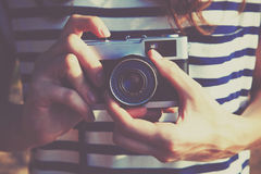 Girl holding retro camera Royalty Free Stock Image
