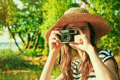 Girl holding retro camera Stock Photo