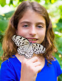 Girl holding Rice Paper butterfly Idea leuconoe Royalty Free Stock Images