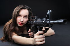 Girl holding Rifle on black background Stock Image
