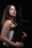 Girl holding Rifle on black background Stock Photography