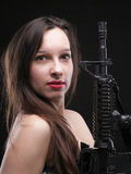 Girl holding Rifle on black background Stock Photo