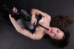 Girl holding Rifle on black background Royalty Free Stock Photography