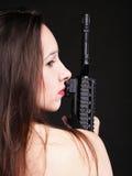 Girl holding Rifle on black background Royalty Free Stock Photo