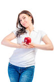 Girl holding a ripe apple Stock Photo