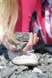 Girl holding rocks Stock Photography