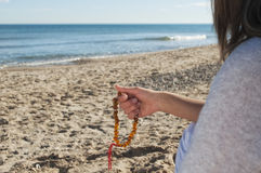 Girl holding a rosary Royalty Free Stock Image