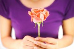 Girl holding rose flower Stock Photo