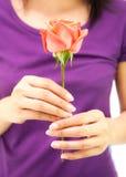 Girl holding rose flower Stock Image