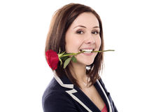 Girl holding rose between her teeth Royalty Free Stock Image