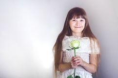 Girl holding a rose Stock Images