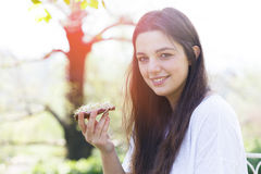 Girl holding rye bread with beetroot cream Stock Images