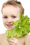 Girl holding salad leaf Royalty Free Stock Images