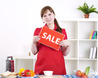 Girl holding sale sign Royalty Free Stock Photography