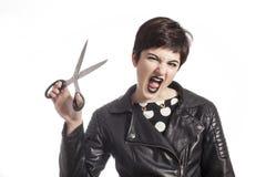 Girl holding scissors on white Stock Images