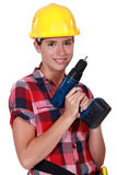 Girl holding a screwdriver. Pretty girl holding an electrical screwdriver Stock Images