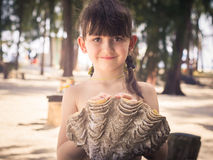 Girl holding seashell Stock Image
