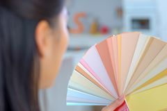 Girl holding and selecting from color palette. Color royalty free stock photo