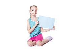 Girl holding a sheet of paper Stock Photos