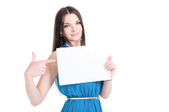 Girl holding a sheet of paper with text space Royalty Free Stock Photography