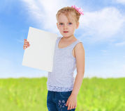 Girl holding a sheet of paper. Stock Image