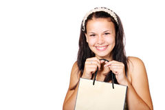 Girl holding a shopping bag. Young woman with a shopping bag isolated on white background Stock Images
