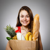 Girl holding shopping bag Stock Images