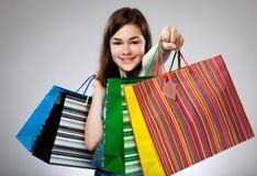 Girl holding shopping bag. On gray background Royalty Free Stock Photo