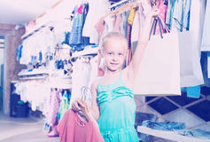 Girl holding shopping bags in children clothes Stock Photo