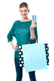Girl holding shopping bags and credit card Stock Image
