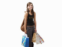 girl holding shopping bags, cut out Royalty Free Stock Images
